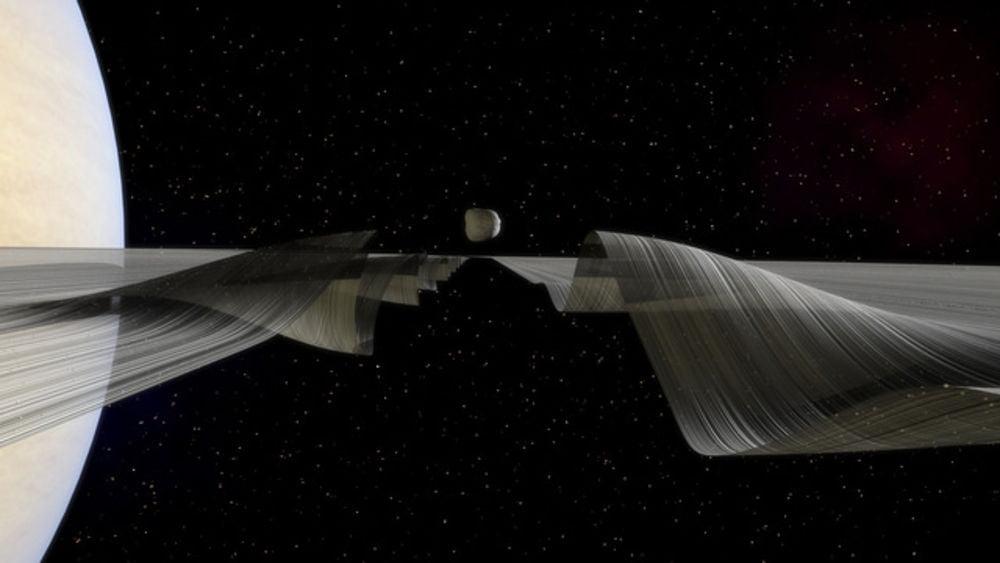 Keeler aralığı boyunca uzanan Daphnis ve dalgaları