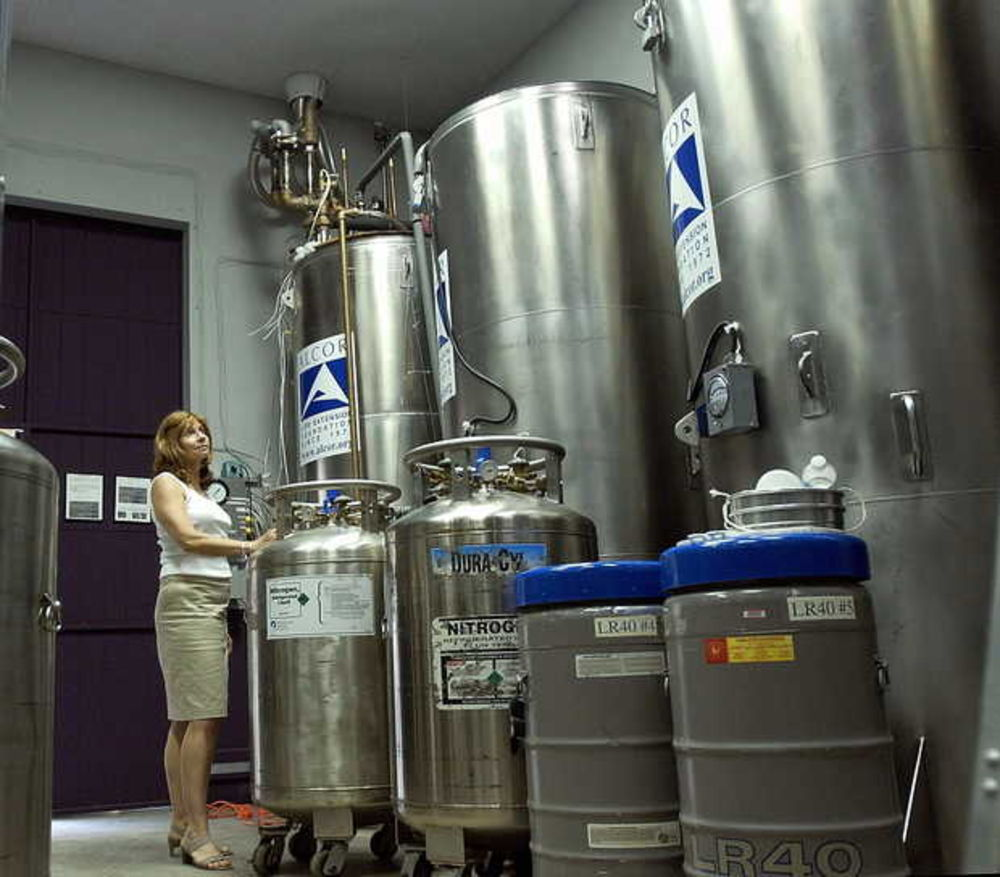 ** ADVANCE FOR WEEKEND EDITIONS AUG. 2-3 ** Alcor Life Extension Foundation public relations manager Paula Lemler looks over storage units which contain liquid hydrogen frozen heads and bodies at the cryogenics lab in Scottsdale, Ariz., Wednesday, July 30, 2003. The room contains 58 patients. Welcome to the resting place of Ted Williams. That it is not intended to be the ``final'' resting place is the whole idea he _ or anyone else _ is here. (AP Photo/Tom Hood)
